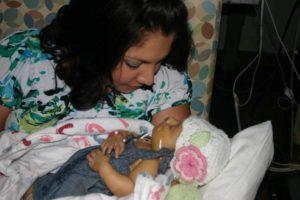 Theresa holding newborn Eden
