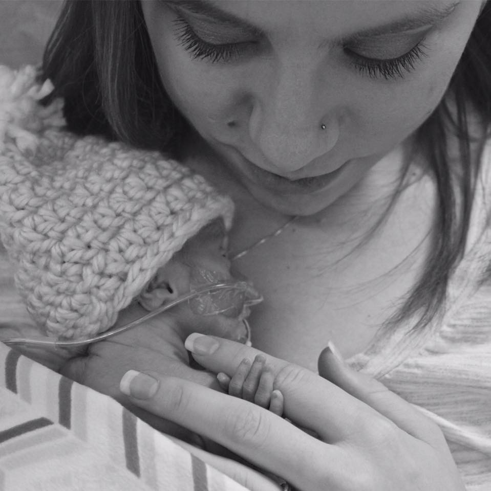 Arielle holding newborn Noah