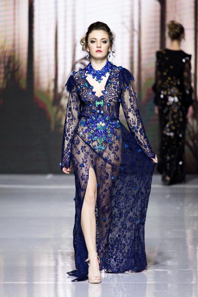 Model walking down runway wearing Agustin's work