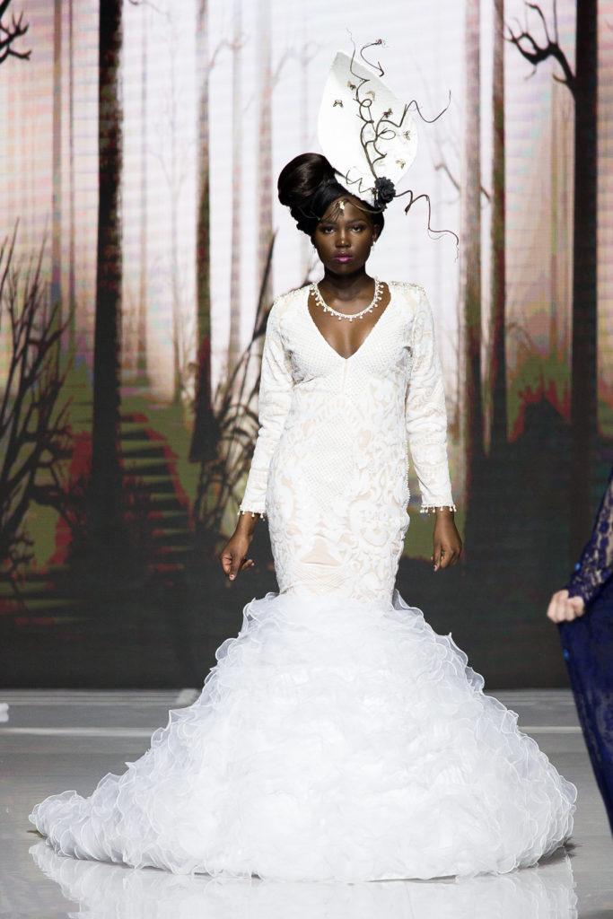 Model walking down runway, wearing Agustin's work
