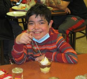 Jonathan enjoying a sundae