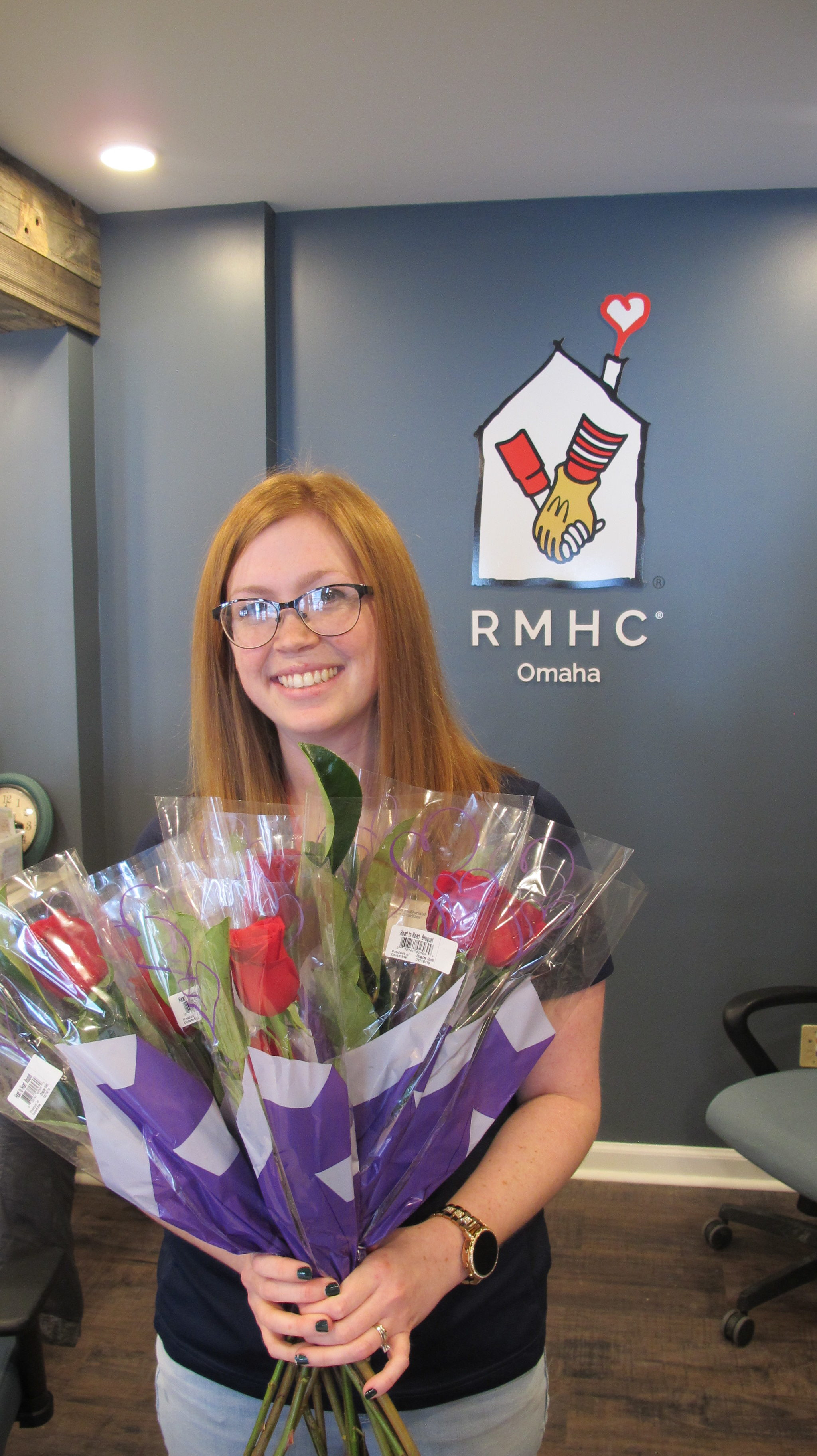 Volunteer Autumn holding roses
