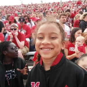 Michael in the stands at a Husker football game